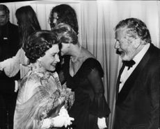 Queen Elizabeth II in concert with Peter Ustinov during charity film premiere at ABC Shaftesbury Avenue