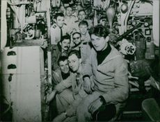 men inside a ship looking and smiling at the camera in Minerve