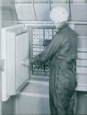 Man working at space research center.