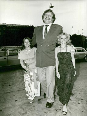 American actor Richard Kiel along with wife Diana (t.v.) and film fiancé Blanché Ravalec