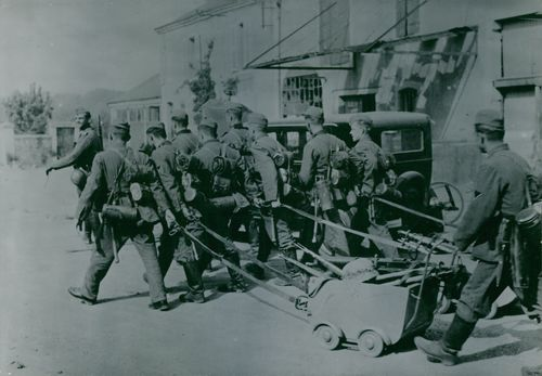 Soldiers carrying their weapons.