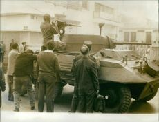 Soldiers ready for shoot from tank.