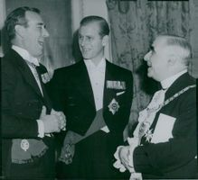 Earl Mountbatten, Prince Philip and Lord Mayor Sir Frederick Wells at a dinner at Mansion House