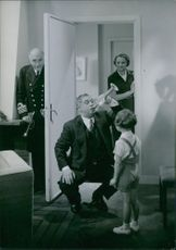 "Olof Winnerstrand, Erik 'Bullen' Berglund, Gösta Bernhard and Birgit Tengroth in a  scene from the film ""Familjens hemlighet"" (eng:The family secret), 1936."
