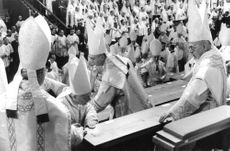 Pope Paul VI with several priests.
