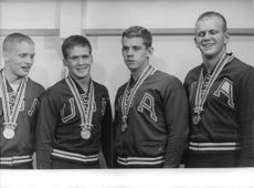 four men wearing a medal, 1964
