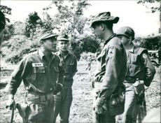 Four military men having a discussion in Indokina.  Taken - 16 Oct. 1961