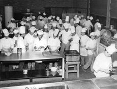 People in commercial kitchen.