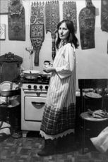 Poet Adia Hmeleva, in the kitchen in the three-room apartment, shared by six people. Hmeleva and her husband fled later to the west.