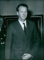 Close up of former Prime Minister of Rhodesia Ian Douglas Smith while he is in formal dress and looking at something