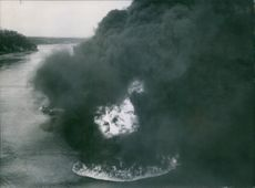 1945 Aerial view of flame and smoke in sea in the oil strips.
