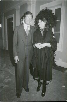 Roger Moore and Anouk Aimee after a dinner at Laurent Restaurant