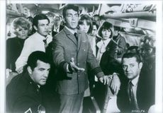 "Dean Martin and Jacqueline Bisset with other casts in the scene of the movie, ""Airport""."