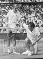 John Newcombe crashes into the net during the match against Stan Smith in the men's final at the Wimbledon Championship