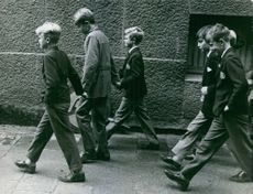 A photo of Carl XVI Gustaf of Sweden walking with his friends on his younger years. 1960