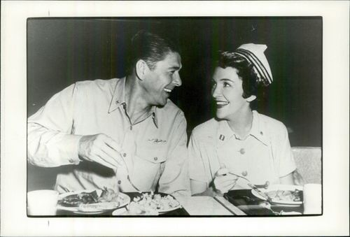 """Ronald Reagan and his wife Nancy eat lunch during the """"Hellcats of the Pacifix"""" record at the San Diego Naval Training Center"""