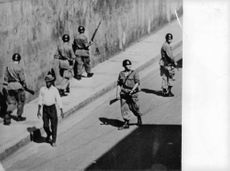 Soldiers wandering the streets of Israel.