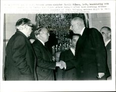 Mr. Harold Wilson and Lord George Brown (L) saying goodbye to President Charles de Gaulle