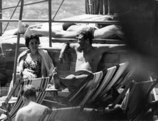 Princess Soraya, former queen of Iran,  accompanied by her mother,  is vacationing on The Isle Of Capri where she was joined by Italian Prince Raimondo Orsini. 1959
