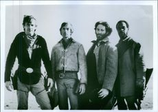 Actors Kevin Costner, Scott Glenn, Kevin Kline and Danny Glover on the set of the film 'Silverado', 1985.