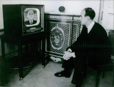 Valéry Giscard d'Estaing watching TV.  President of the French Republic from 1974 until 1981 and who is now a member of the Constitutional Council of France. Year: 1962