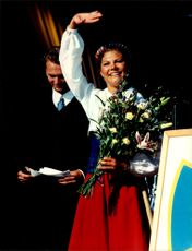 Crown Princess Victoria laughs and waves to the camera during her 20th anniversary with the Solliden family.