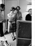Juan Carlos I`s wife Sofia standing besides a woman looking at a board.