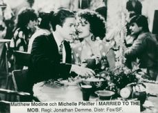 "Matthew Modine and Michelle Pfeiffer in the movie ""Married to the Mafia"""