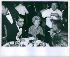 Kurt Kasznar and Janet Gaynor by a table.