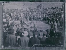 Crowd gathered on the wide field to witness the event.