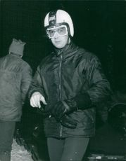 Prince Michael of Kent wears his helmet as he gets ready to ride the bobsled/ January, 1970.