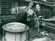 R2 in Studsvik. Engineer Paul Näslund (t.v.) who designed the air cooler along with civ ing Peter Margen