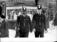Policemen on patrol in London.