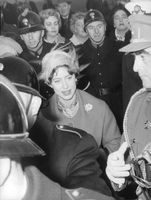 Princess Margaret standing in crowded people.