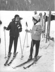 Princess Alexandra skiing on ice with a woman, 1962.