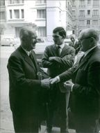 Gaston Defferre and Guy Mollet shaking hands, 1965.