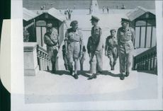 Lieutenant General McCerry accompanied by Field Marshal Alexander with other people during his tour of the beach area of the rest camp.