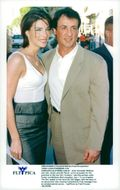 "Sylvester Stallone with his wife Jennifer Flavin attends the premiere of ""Contact"""