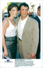 """Sylvester Stallone with his wife Jennifer Flavin attends the premiere of """"Contact"""""""