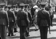 Princess Anne walking among soldiers.