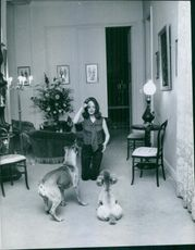 Etchika Choureau playing with the dogs, 1969.