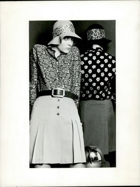 Women wearing skirts, long sleeves and hats in 1969.