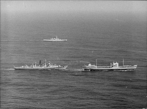 British frigate is in the background while the Soviet hunter is tanker of tankers