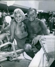 Gloria Pall and Ed Gardner having fun together at the beach.