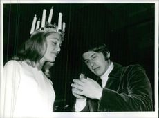 Kerstin Asp as Lucia and man looking at lighter, 1968.