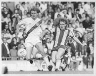 Peter Nicholas and Derek Statham are fighting for the ball