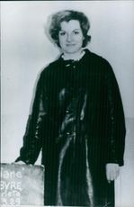 A photo of a woman wearing leather jacket.