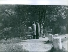 andrey-gromyko in the park and having conversation from the man beside him. 1959