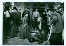 Linda Hunt confronts Brian Dennehy after a shootout as Kevin Kline and Scott Glenn look on the film Silverado.