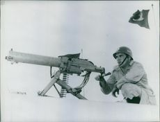 Man with machine gun.
